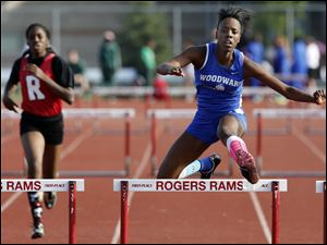 Tymeshia Childress of Woodward  High School wins the 300 meter hurdles.