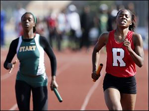 Sasha Dailey, right,  of Rogers High School runs the final leg of the 4X200 meter relay edging Start High School's Daesha Ware.