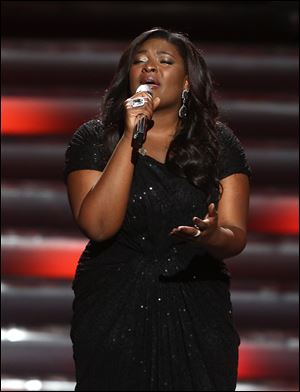 "Winner Candice Glover performs at the ""American Idol"" finale at the Nokia Theatre a"