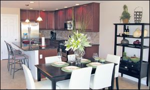 This lovely island kitchen is open to the dining area. Both are open to the great room.