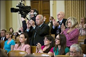 Members of the audience applaud after Rep. Mike Kelly (R., Pa.), a member of the House Ways and Means Committee, criticized ousted IRS chief Steven Miller during a hearing on IRS scrutiny of conservative groups.