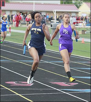 Notre Dame's Chantalia Young defeats Fremont Ross' Ariana Spencer at the finish of the 400-meter relay. Young also won the 100 and 200.