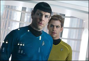 Zachary Quinto, left, as Spock and Chris Pine as Kirk star in the movie, 'Star Trek Into Darkness.'