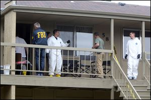 Federal authorities search an apartment in Boise, Idaho on Cassia Drive on Thursday afternoon. U.S. authorities in Idaho said they have arrested a man from Uzbekistan accused of conspiring with a designated terrorist organization in his home country and helping scheme to use a weapon of mass destruction.