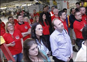 Employees watch as the 1 millionth Jeep Wrangler rolls off the line at Chrysler in Toledo.