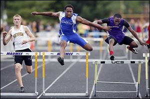 Ose Omofoma of Anthony Wayne leads Adam Downing, left, of Northview and Andre Johnson of Maumee on his way to winning the 300-meter hurdles at the NLL meet.