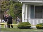 Waterville Township police and OHIO BCI crime scene unit investigate a fatal shooting on S. River Rd. In Waterville, Ohio.