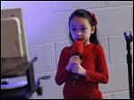 Anabelle Nagy, 6, sang Friday evening during a live karaoke night at Zoar Lutheran Church in Perrysburg.