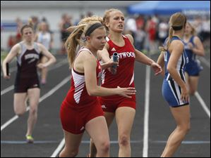 Eastwood's Aricka LaVoy hands off to Kortni Montag. Eastwood won this 4x400 meter run.