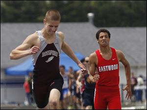 Rossford's Ryan Clay wins the 800 meter run. Eastwood's Tim Hoodlebrink takes 2nd.