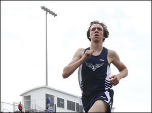 Lake's Tyler Rickman breaks the meet record in the 3200 meter run.