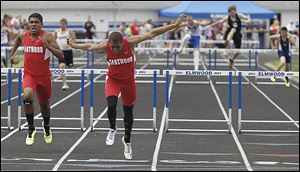 Eastwood's Devin Snowden beats teammate Joey Salinas in a 300-meter hurdles heat. Snowden won the final and also captured the long jump and ran on two winning relay teams at the Northern Buckeye Conference meet.
