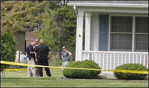 State and local authorities investigate a fatal shooting and home invasion on South River Road in Waterville Township.
