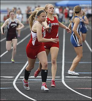 Eastwood's Aricka LaVoy hands off to Kortni Montag as the Eagles won  the 1600-meter relay. LaVoy also won the long jump and helped win the 400 relay.
