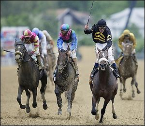 Jockey Gary Stevens celebrates aboard Oxbow after winning the 138th Preakness Stakes. Itsmyluckyday, center, finished second; and Mylute, left, was third.