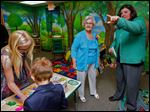 Harriet Loar, left, gets a guided tour of the new Harriet Loar Early Literacy Center from Children's Librarian Martie Yunker at the Evergreen Community Library in Metamora, Ohio. The educational center will be open during library hours, except for the story-time hour on Wednesdays.