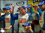 Ken Schrader, center, celebrates in Victory Lane after claiming the Menards 200 on Sunday afternoon at Toledo Speedway. It was the first ARCA start of the season for the longtime driver.