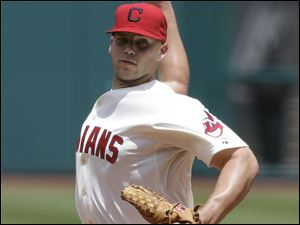 Cleveland Indians starting pitcher Justin Masterson delivers in the first inning of a baseball game against the Seattle Mariners.