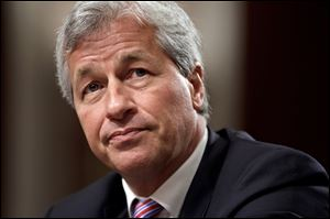 JPMorgan Chase's Jamie Dimon, chairman and CEO of the largest bank in the United States, faces a key test this week: His shareholders are voting on whether to let him keep both jobs.