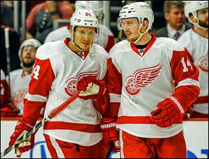 The Red Wings' Gustav Nyquist, right, smiles as he talks with Damien Brunner during Game 2 against Chicago. The duo are a major part of Detroit's youth movement this season.