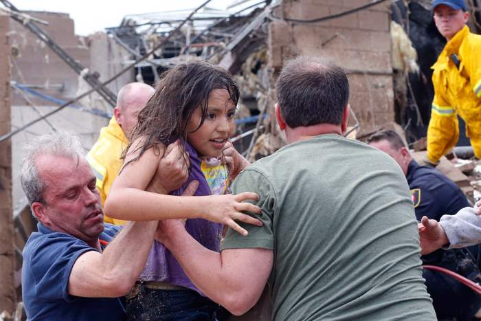 A-child-is-pulled-from-the-rubble-of-the-Plaz