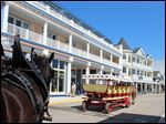 Mackinac Island's newest hotel, the Bicycle Street Inn& Suites on Main Street, is opposite Shepler's dock. The resort island between lakes Huron and Michigan that bans cars and yet draws close to a million visitors each year is facing key decisions on what development to allow to accommodate the tourist business that keeps it alive.