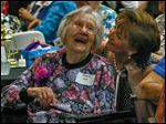 Bowling Green Manor resident Fern Sipe, 101, shares a laugh with Jackie Metz, volunteer coordinator for the Wood County Committee on Aging, at the 90 Plus Spectacular in Bowling Green.