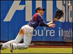 Mud Hens right fielder Ben Guez makes a diving catch of a sacrifice fly hit by  Syracuse Chiefs first baseman Chris Marrero in the 10th inning which allowed Jeff Kobernus to score from third base.