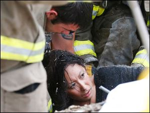 A woman is pulled out from under tornado debris at the Plaza Towers School.