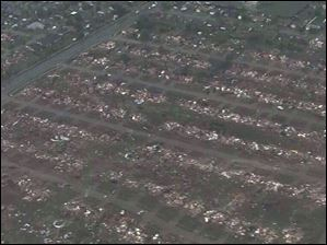 This photo provided by KFOR-TV shows homes flattened outside Moore.