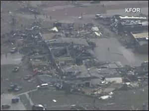 Screen grab image of KCPQ Seattle footage of Shawnee, Oklahoma tornado damage.