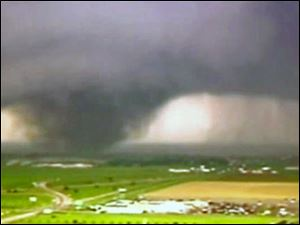Screen grab of Associated Press video of the massive tornado that hit Oklahoma Monday.