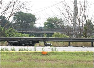 A motorcycle was wedged between the guardrail and the berm of I-475 in a 2011 crash with other vehicles.