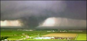 A screenshot of video footage of a tornado in Oklahoma.