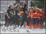 Clay players run off the field in celebration after defeating Southview in a Division I district semifinal softball game at Rolf Park in Maumee.