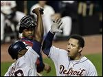 Detroit Tigers' Miguel Cabrera (24) is congratulated by Torii Hunter (48) after a two-run home run.