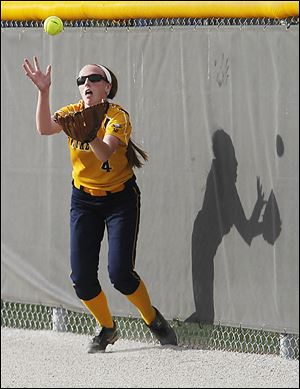 Notre Dame's Sarah Long attempts to make a catch on a hit by a Springfield player.