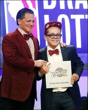 Cleveland Cavaliers owner Dan Gilbert poses with his son Nick Gilbert after winning the NBA basketball draft lottery today in New York.