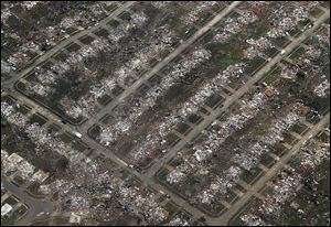 An aerial view of an entire neighborhood in Moore, Okla., illustrates the severity of Monday's tornado. The twister roared through the Oklahoma City suburb on a 20-mile path of destruction.