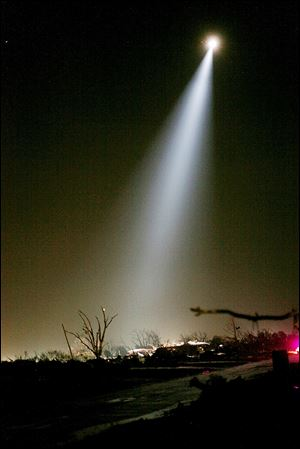 Rescue workers combed through the rubble Monday night and Tuesday morning using spotlights from helicopters.