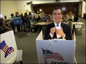 Los Angeles Mayoral candidate Eric Garcetti votes early Tuesday morning in Los Angeles. Garcetti defeated Wendy Greuel in a mayoral runoff.