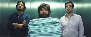 "Bradley Cooper as Phil, left, Zach Galifianakis as Alan, center, and Ed Hlems as Stu in a scene from ""The Hangover Part III."""