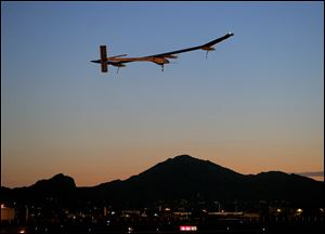 Solar Impulse, piloted by André Borschberg, takes flight during the second leg of the 2013 Across America mission, at dawn, today from Sky Harbor International Airport in Phoenix.