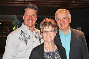 The Denker Family (Brett, Diana, Rollie) at the True Blue To Do gala.