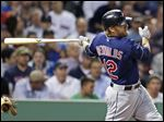 Cleveland Indians' Mark Reynolds follows through on a two-run single during the third inning of a baseball game against the Boston Red Sox at Fenway Park in Boston, Thursday, May 23, 2013. (AP Photo/Charles Krupa)