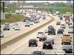 Traffic moves along Interstate 90 in Des Plaines, Illinois.