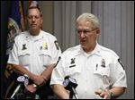 Toledo Deputy Police Chief Don Kenney talks during a news conference at the Safety Building about the shooting of Thomas Bean by Toledo police officers today. Captain Brad Weis is at back left.