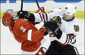 Chicago Blackhawks center Michal Handzus mixes it up with Detroit's Brendan Smith during the second period.
