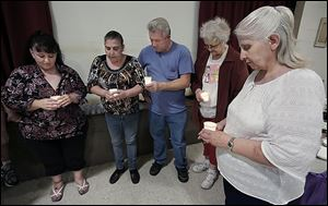 From left, Risa Smith, Beth Stump, Terry Stump,  Nevaeh Buchanan's great-aunt Diana Lawson, and Nevaeh's grandmother Sherry Buchanan participate in a candlelight vigil organized by Justice For Nevaeh.  The vigil in Monroe on Wednesday marked four years since Nevaeh Buchanan was abducted and later found murdered.