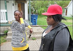 Darlene Woodmoore, left, and Tiffany Bean talk about the fatal shooting of Thomas Bean outside his home at 1029 Page St. Tiffany Bean is Thomas Bean's daughter; Ms. Woodmoore is his cousin.